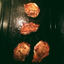 Chicken Thighs Getting Crispy on the Cast Iron Griddle