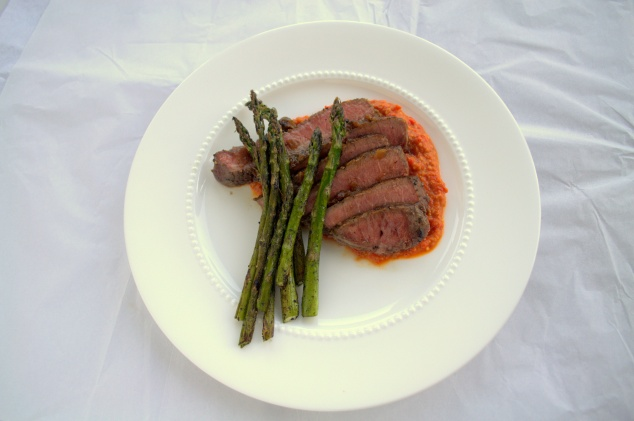 A weeknight dinner of steak and asparagus, brightened up with romesco sauce.